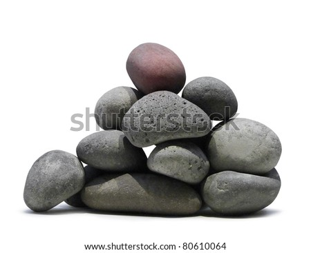 Smooth lava stones stacked pile on white background isolated - stock photo