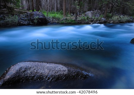 smooth river flow in Yosemite - stock photo