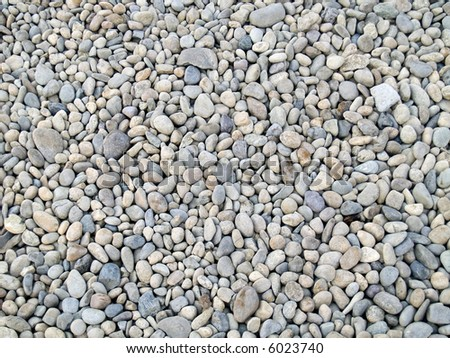 Smooth river stone background. - stock photo
