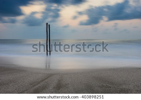 Smooth sea beach and pole