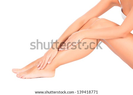 Smooth skin on female legs. White background, copyspace  - stock photo