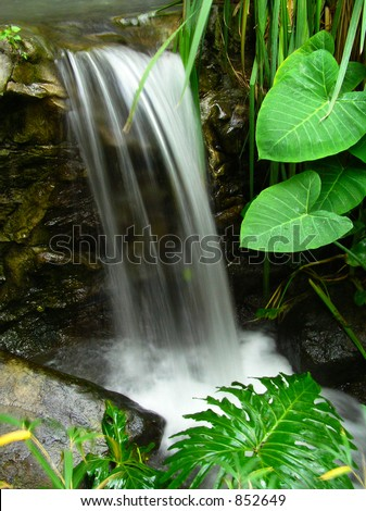 Smooth Waterfall and Leaves-Alternate Angle - stock photo