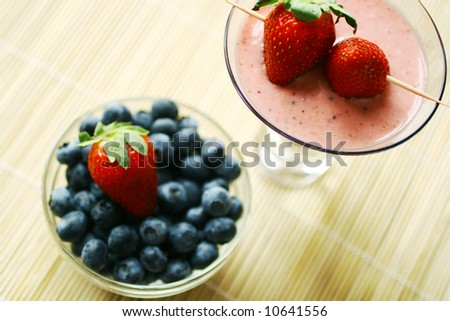 smoothie and fresh berries - stock photo