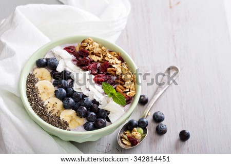 Smoothie bowl with chia, banana, blueberry and coconut - stock photo