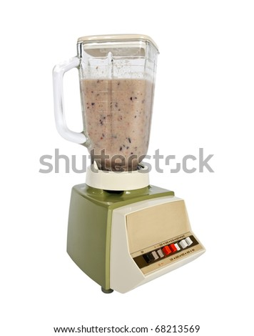 Smoothie freshly made in a vintage 1960's blender. - stock photo