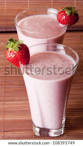 Smoothie strawberry served with fresh strawberry - stock photo
