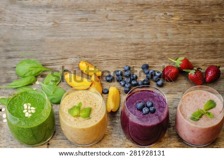 smoothie with blueberries, peach, spinach and strawberries. the toning. selective focus - stock photo