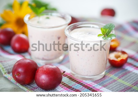 smoothie with fresh cherry plum in cups - stock photo