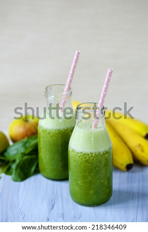 Smoothie with spinach, apples and bananas - stock photo