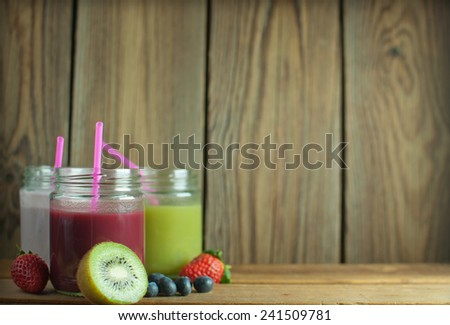 Smoothies in jars with space for text - stock photo