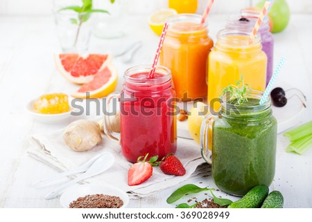 Smoothies, juices, beverages, drinks variety with fresh fruits and berries on a white wooden background - stock photo