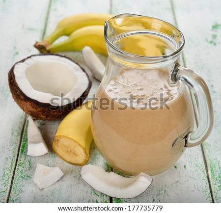Smoothies with coconut milk and banana on a white background - stock photo