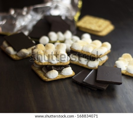 Smores. Chocolate and marshmallow and crackers. Selective focus. - stock photo