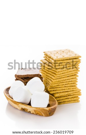 Smores station with large white marshmallows at the party. - stock photo