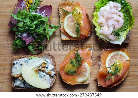 Smorgasbord: Scandinavian open sandwiches - stock photo