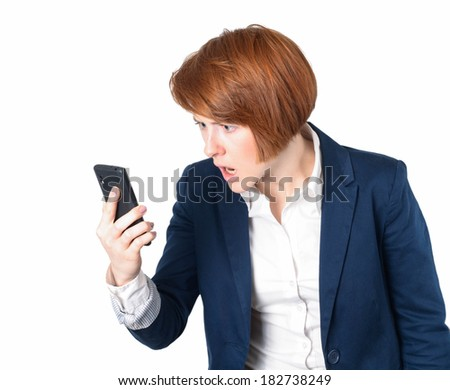 SMS. Funny young businesswoman reading bad news text message. Beautiful young caucasian woman with redhead isolated on white background holding her smart phone  - stock photo
