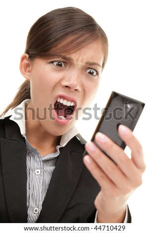 SMS. Funny young businesswoman reading bad news text message. Beautiful young mixed race chinese / caucasian woman isolated on white background.