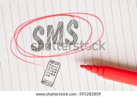 SMS note in a red marked circle on linear paper