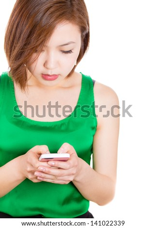SMS on cellphone. Beautiful woman reading a sms on her mobile phone  - stock photo