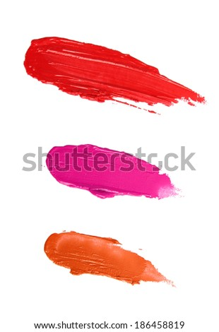 Smudged lip gloss or lipstick samples isolated on white - stock photo