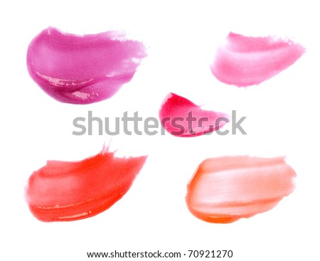 Smudged lipgloss or lipstick  samples isolated on white
