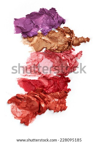 Smudged lipsticks isolated on white background
