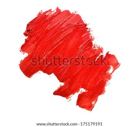 smudged lipsticks on white background - stock photo