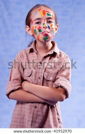 Smudged little painter showing tongue - stock photo