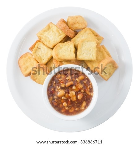 Snack and Dessert, Chinese Golden Deep Fried Tofu or Fried Bean Curd Served with Sweet and Sour Spicy Sauce Isolated on White Background. - stock photo