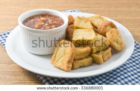 Snack and Dessert, Chinese Traditional Deep Fried Tofu or Fried Bean Curd Served with Sweet and Sour Spicy Sauce. - stock photo