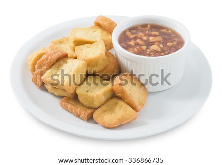 Snack and Dessert, Plate of Chinese Traditional Deep Fried Tofu or Fried Bean Curd Served with Sweet and Sour Spicy Sauce Isolated on White Background. - stock photo
