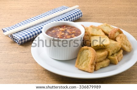 Snack and Dessert, Plate of Chinese Traditional Deep Fried Tofu or Fried Bean Curd Served with Sweet and Sour Spicy Sauce. - stock photo