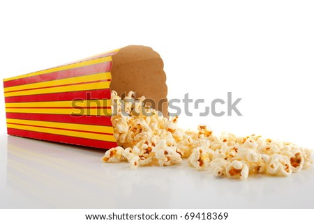 Snack box with popcorn dropped . - stock photo