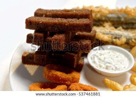 snack, brown bread, french fries fish squid, white sauce