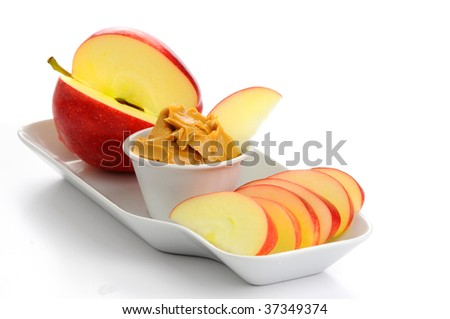 Snack consisting of ripe apple and peanut butter. - stock photo