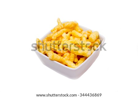 Snack corn cheese in square bowl on a white background
