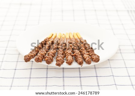 Snack food biscuit stick chocolate coated - stock photo
