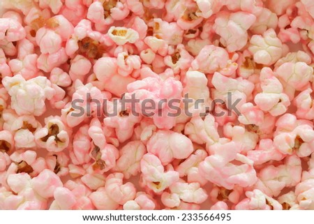 Snack food, pink pop corn flavored by strawberry and milk - stock photo