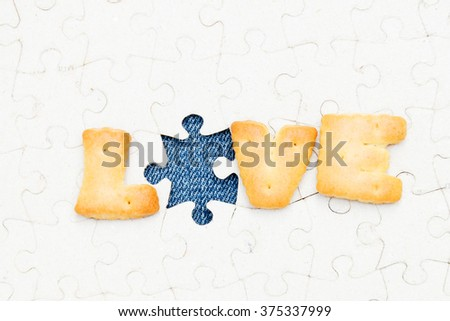 "snack food with message ""LOVE""  on old Jigsaw"
