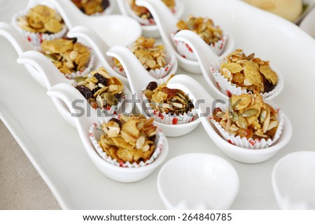 Snack nuts placed on a spoon - stock photo