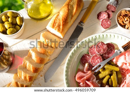 Mediterranean food appetizers, antipasto with French bread baguette ...