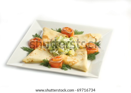 Snack with a salmon on a light plate on a white background a shot horizontal - stock photo