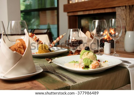 snacks and glasses of wine on bartender counter in restaurant - stock photo