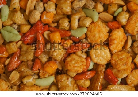 Snacks background with salty crunchy treats, Japanese Otsumami rice cracker  snack chip and peanut - stock photo