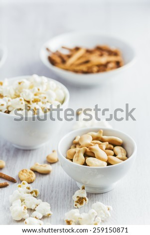 Snacks on white wooden background - stock photo