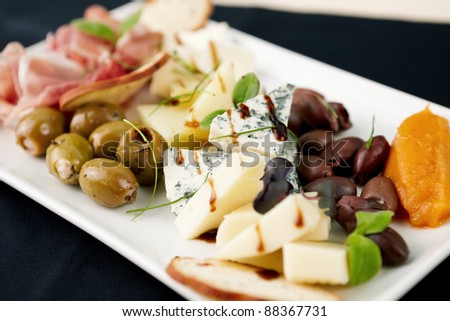 Snacks selection for wines (Parma ham, olives, cheese) - stock photo