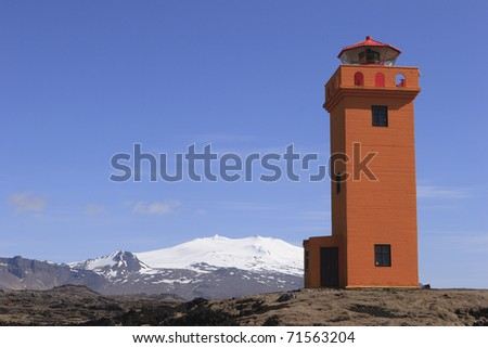 Snaefellsjokull Volcano and lighthouse - stock photo