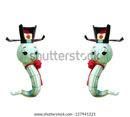 Snake ornamental lantern wearing a Chinese imperial court hat with a red ribbon, isolated against white, for the concept of Chinese astrology year of the snake. - stock photo