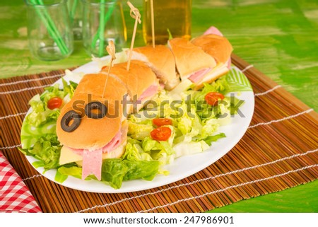 Snake sandwich with fresh salad, creative food for kids - stock photo