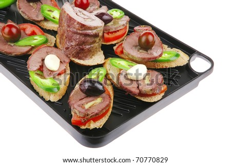 snakes on black grill plate : meaty sandwiches with supplements in grill plate isolated over white background